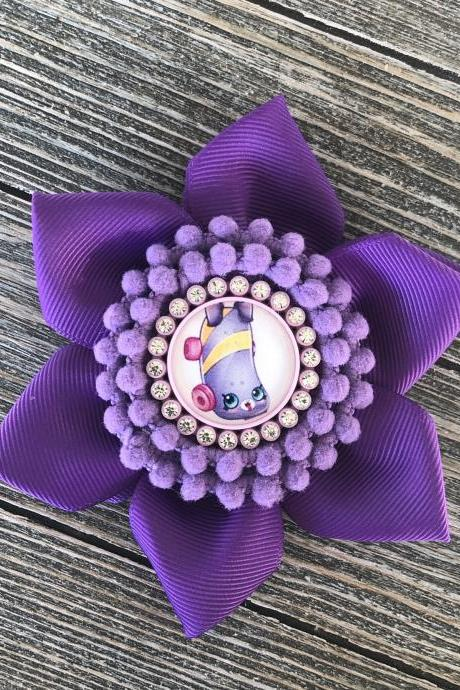Purple with lavender flower bow with pom poms center