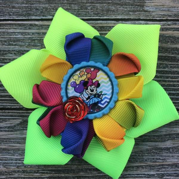 Rainbow Minnie Mouse inspired bow.